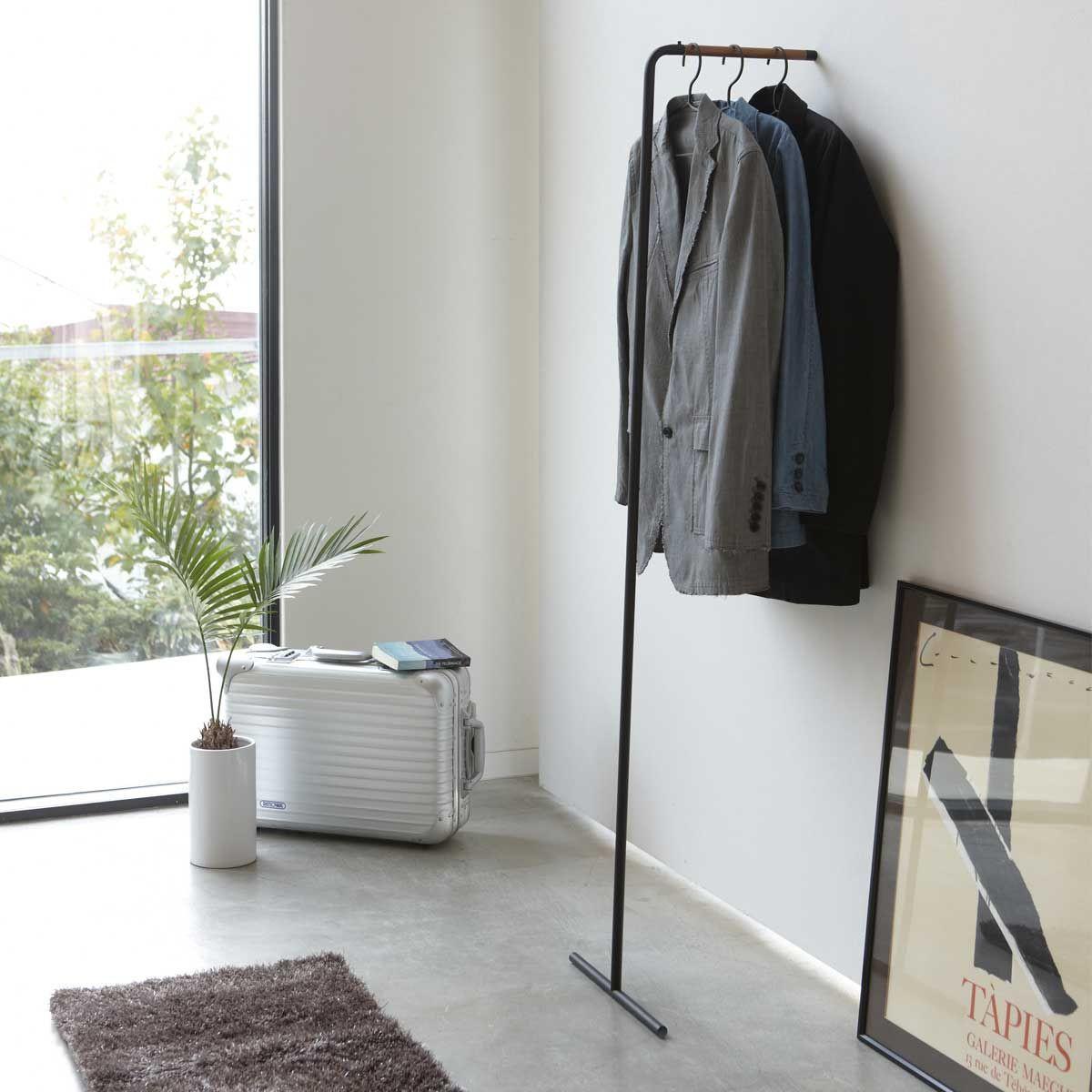 portant v tements mural design. Black Bedroom Furniture Sets. Home Design Ideas